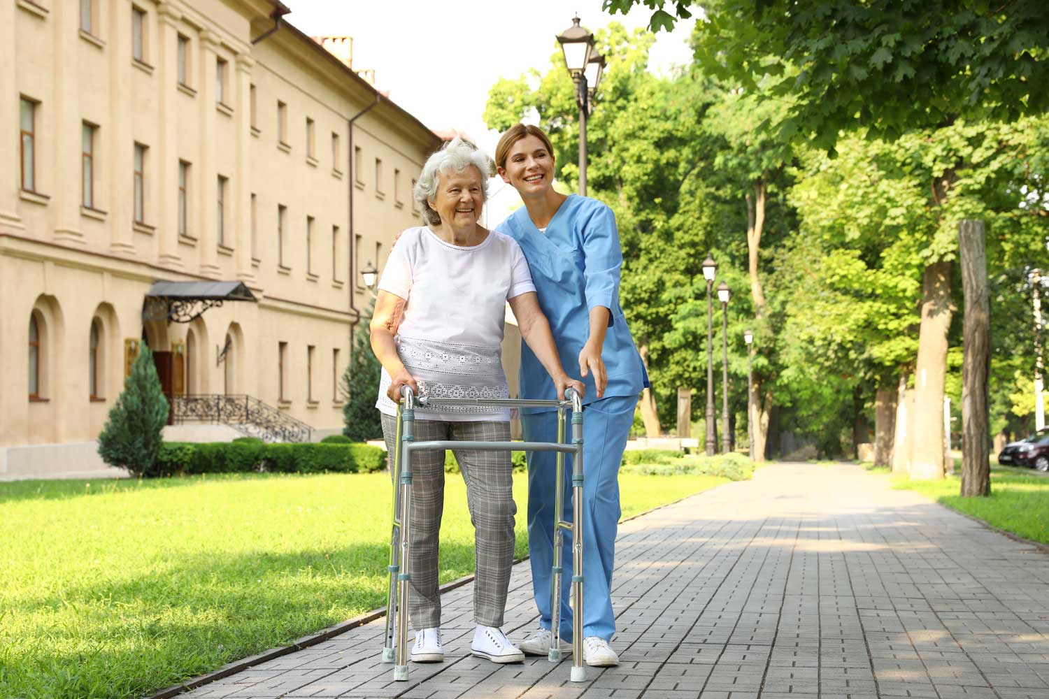 bigstock-Happy-Nurse-Assisting-Elderly--318319204